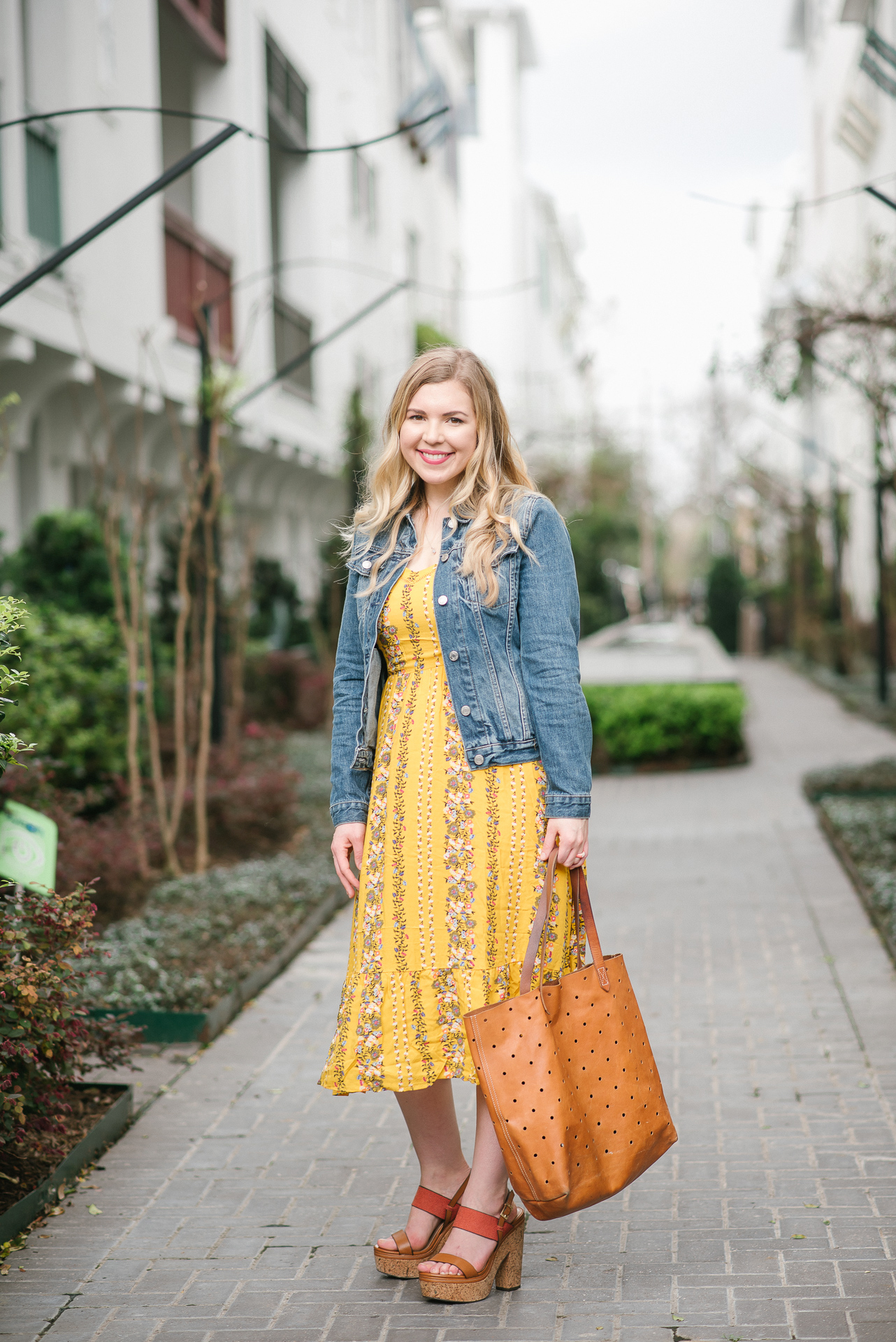 Yellow Floral Dress, Denim Jacket and Madewell Brown Leather Tote Worn By Jillian Goltzman of Cup of Charisma