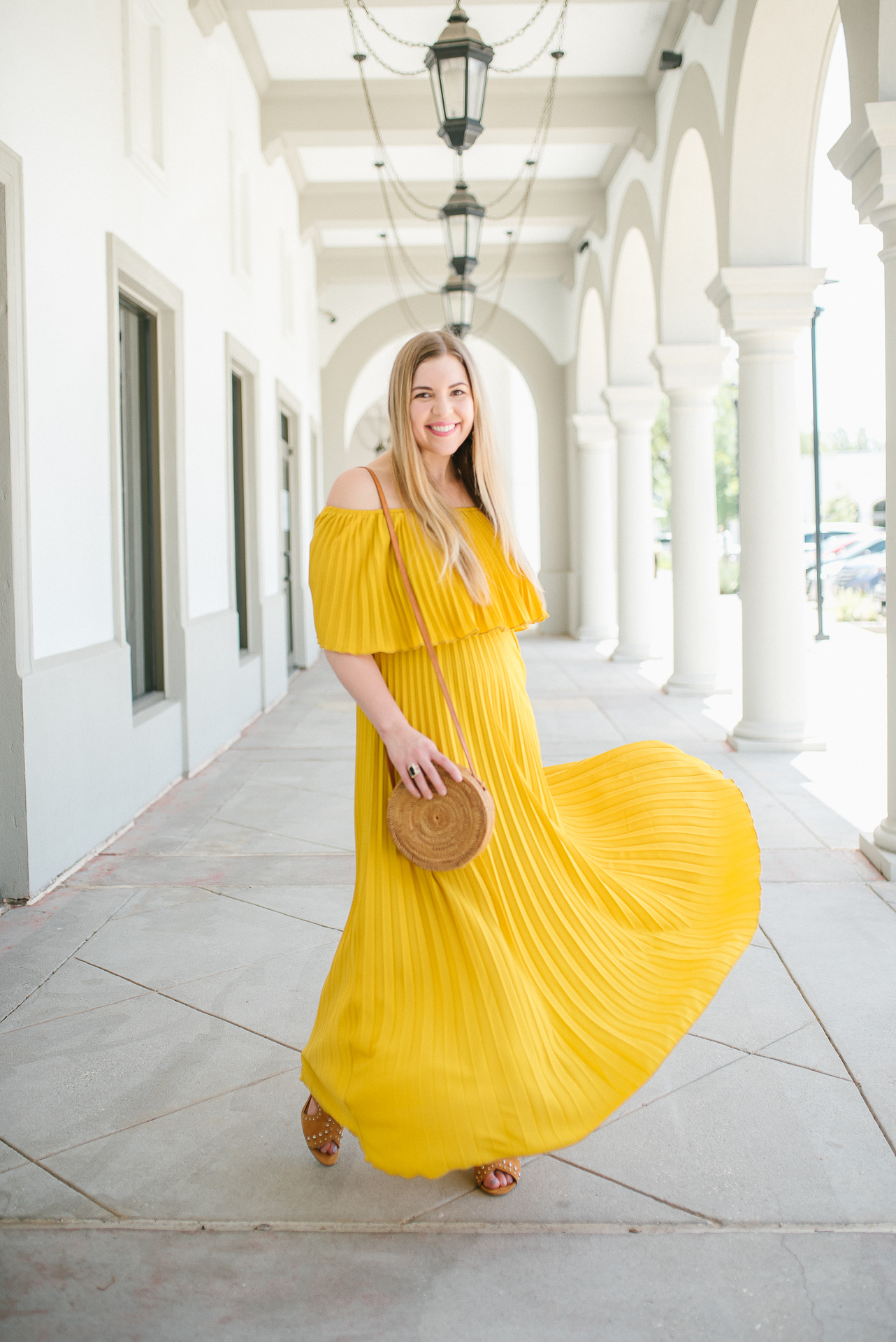 8 Amazing Dresses for Summer Travel - Yellow Pleated Maxi Dress worn by Cup of Charisma Jillian Goltzman Houston Fashion Blogger 1